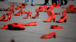Pairs of women'S red shoes, put on display by Mexican visual artist Elina Chauvet to protest against gender violence and femicide, are pictured at Zocalo square in Mexico City, Mexico January 11, 20