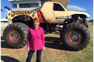 Pauline Hanson stands in front of a monster truck