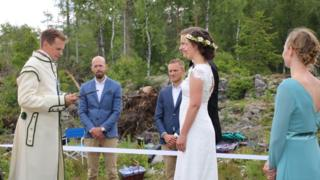 Couple getting married in forest