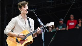 Shawn Mendes playing guitar