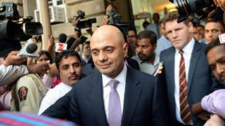 Business Secretary Sajid Javid leaves after meeting Tata Group Chairman Cyrus Mistry