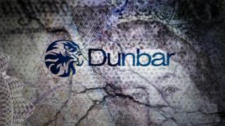 Dunbar bank logo on background of bank notes