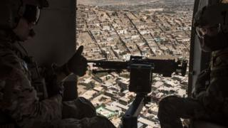 US gunners inside helicopters for Afghanistan