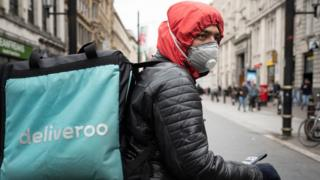 Deliveroo driver wearing a mask in Cardiff, Wales