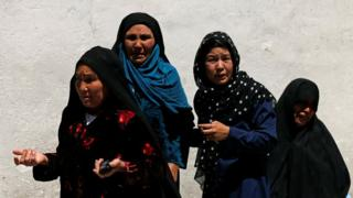 Relatives of the victims mourn at a hospital after a suicide attack in Kabul, Afghanistan, 22 April