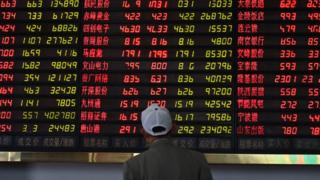 A man looks at stock market data in Shanghai