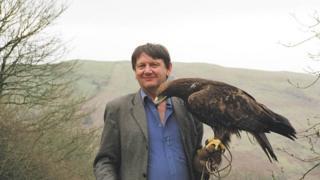 Carl Jones with an eagle