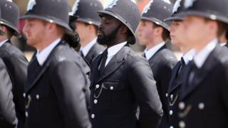 Newly qualified Metropolitan police officers take part in their Passing out Parade