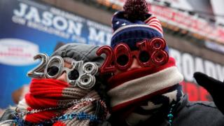 """Revelers gather in Times Square as a cold weather front hits the region ahead of New Year""""s celebrations in Manhattan, New York, U.S., December 31, 2017."""