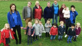 Councillor Lewis Young (back row, left) with families from North Ormesby