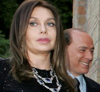Italy's Prime Minister Silvio Berlusconi and his wife Veronica Lario are seen in Rome on 4 June, 2004
