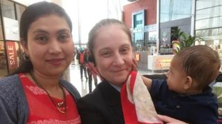 Krishna Barot and her son Nitul with security guard Michelle Mckeller