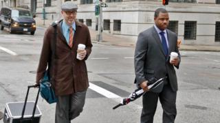 William Porter and one of his lawyers walk to the courthouse in Baltimore