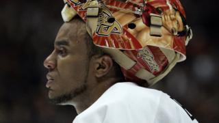 Ottawa Senators goaltender Ray Emery takes a break in between periods with his graphic helmet