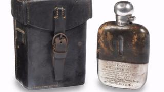 The flask is hallmarked 'John Yates & Son, Birmingham, Sterling Silver, 1906