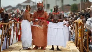 Newly crowned Oba of Benin is guided through a symbolic bridge by the palace chiefs during his coronation in Benin, Nigeria - Thursday 20 October 2016