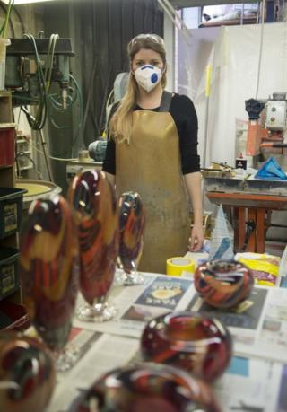 Woman in a workshop wearing a facemask