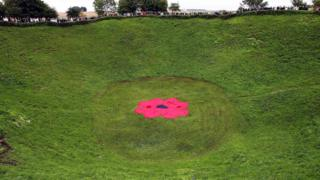 People stand around the Lochnagar Crater