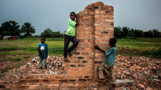 - Young Congolese boys play around broken building on October 26, 2017 in Kasala, in the restive region of Kasai, central Democratic Republic of Congo. Conflict in the Kasai Provinces between the local militia, Kamwina Nsapu and Government troops have displaced 1.4 million people since August, 2016. As three crop cycles have been missed and displacement continues, sever malnutrition is becoming a present issue.