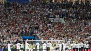 England fans try to console the players after defeat by Croatia