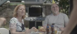A screenshot of an Australian same-sex marriage TV advert which centres around a family barbecue