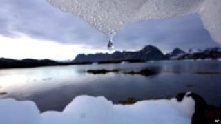 Iceberg melts in Kulusuk, Greenland near the arctic circle