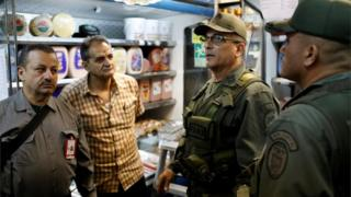 Vice-Admiral Victor Placencia (2nd R) takes part in a special inspection of Venezuelan soldiers to a municipal market in Caracas, Venezuela June 20, 2018.