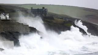 in_pictures Waves crash into the wall at Porthleven in Cornwall, as Storm Ciara pummels the British coastline, 9 February 2020