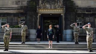 First Minister Nicola Sturgeon marks the VE Day two-minute silence outside St Andrew's House on May 8, 2020 in Edinburgh