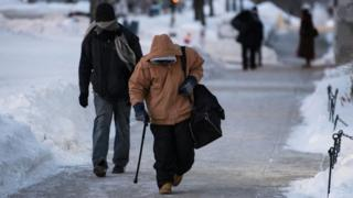 Men walking to a homeless shelter in Madison, Wisconsin