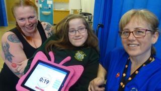 Tia with mother Elaine Saddington and community children's nurse Ann Marie Boland