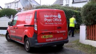 Post van and postman delivering post