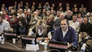 Members of the public and journalists watch as councillors attend a City Council meeting on the end of the pork alternative menu in schools in September 2015 in Chalon-sur-Saone