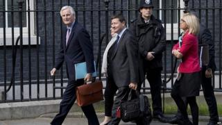 Michel Barnier and other EU officials arriving in Downing Street