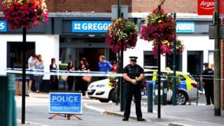 Police at the scene in Tiverton