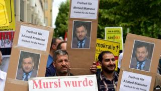 Supporters of Ahmed Mansour demand his release outside a court in Berlin's Tiergarten district