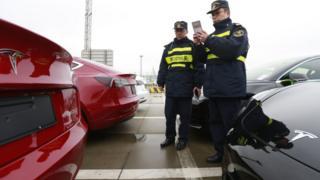 China custom officers examine Tesla Model 3 cars