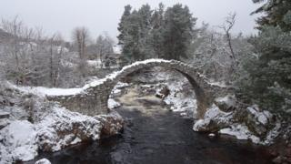 old packhorse bridge in a snowy scene