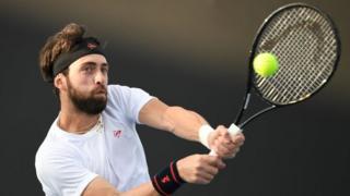 Nikoloz Basilashvili plays at the Australian Open in Melbourne. Photo: January 2020