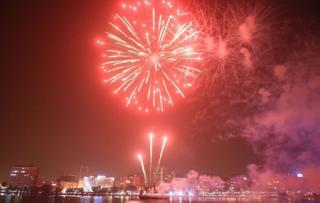 Fireworks light up the night skyline in Abidjan