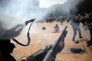 A student is seen during clashes with South African police at Johannesburg's University of the Witwatersrand, South Africa.