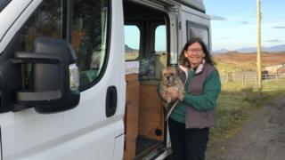 Rev Fiona Ogg and her dog Maisie with the van