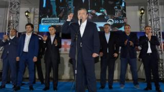 Georgian Prime Minister and leader of ruling Georgian Dream party Giorgi Kvirikashvili addresses to supporters during a rally in Tbilisi, Georgia, Saturday, Oct. 8, 2016