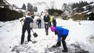 People shovelling snow