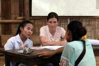 Gracia Fellmeth and a colleague talks to a young woman in Mae La