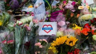 Floral tributes and messages left near Borough Market, London