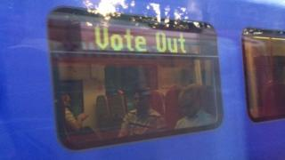 South West Train with Vote Out sign