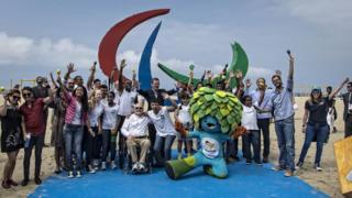 Brazilian Paralympians pose with the mascot of the Games in Rio