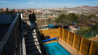 Yoav Sorek is seen as he walks down a staircase at his bed and breakfast 'Nof Ofra' in Israeli settlement in occupied West Bank on 28 January 2016
