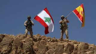 Handout from the Lebanese army shows troops waving both the Lebanese and Spanish flags in the territory of Ras Baalbek
